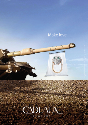 Cadeaux Jewelry Tank Ad, with Kult Ring Skull, fully set with diamonds.