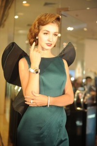 Model with Corum Feather watch in 18 Kt gold with dial made of a genuine Peacock feather and diamonds, Cadeaux Jewelry bangle Bremen, fully set with pavé diamonds and matching ring and earpieces. Venue: Grand Opening of Cadeaux Jewelry at Gaysorn, Bangkok, 15th July 2015.